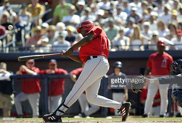 Vladimir Guerrero of the Anaheim Angels pops the ball foul before hitting a home run against the Seattle Mariners on March 8 2004 at Peoria Stadium...