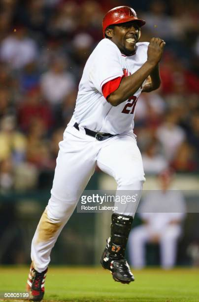 Vladimir Guerrero of the Anaheim Angels runs to first base but is thrown out against the Detroit Tigers on May 5 2004 at Angel Stadium of Anaheim in...