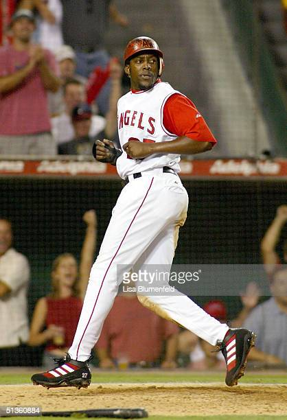 Vladimir Guerrero of the Anaheim Angels scores on an RBI bunt by Bengie Molina in the eighth inning against the Oakland Athletics on September 26...