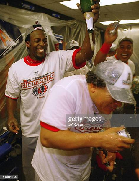Vladimir Guerrero of the Anaheim Angels showers teammate Bartolo Colon with champagne following the Angels 54 victory over the Oakland A's to clinch...