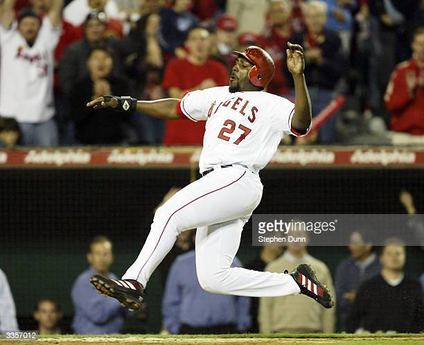 Vladimir Guerrero of the Anaheim Angels slides safely into home with his team's sixth run in the seventh inning against the Seattle Mariners on April...