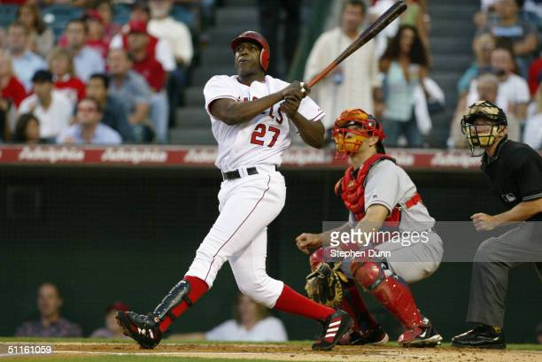 Vladimir Guerrero of the Anaheim Angels watches the ball as he hits a two run home run to left field against the Boston Red Sox in the first inning...