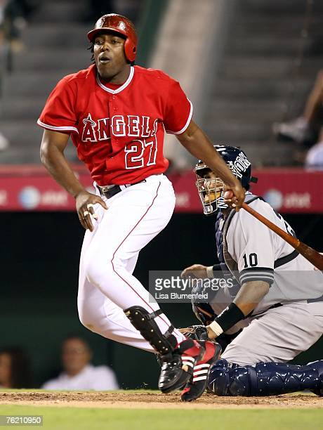 Vladimir Guerrero of the Los Angeles Angels of Anaheim hits a RBI double in the second inning against the New York Yankees at Angels Stadium on...