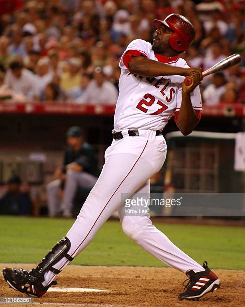 Vladimir Guerrero of the Los Angeles Angels of Anaheim hits a solo home run in the sixth inning of 40 victory over the Tampa Bay Devil Rays at Angel...