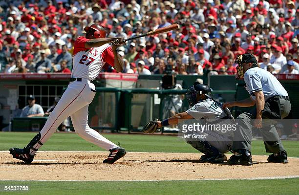 Vladimir Guerrero of the Los Angeles Angels of Anaheim hits a two-run homerun in the third inning as catcher Yorvit Torrealba of the Seattle Mariners...