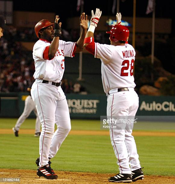 Vladimir Guerrero of the Los Angeles Angels of Anaheim is congratulated by Bengie Molina after scoring the winning run in 32 victory over the Florida...