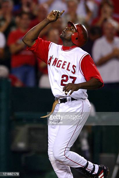 Vladimir Guerrero of the Los Angeles Angels of Anaheim points skyward after hitting a threerun home run for his 18th homer of the season in the third...