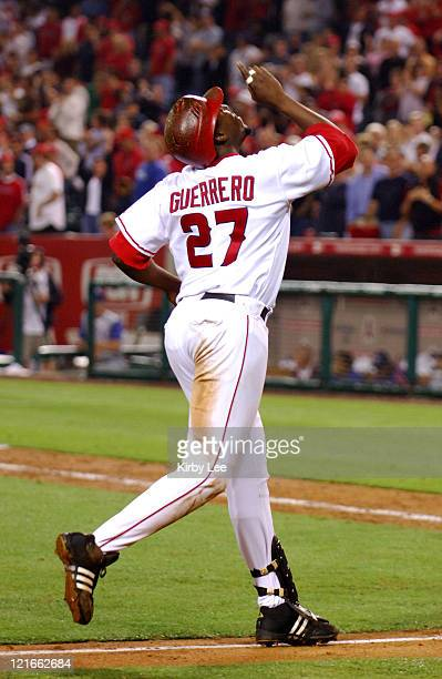 Vladimir Guerrero of the Los Angeles Angels of Anaheim points skyward in celebration after hitting a solo home run in the eighth inning of 83 victory...