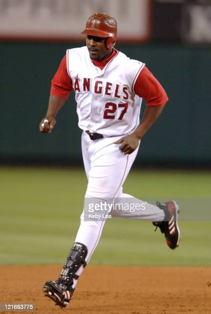 Vladimir Guerrero of the Los Angeles Angels of Anaheim rounds the bases after a grandslam home run in the seventh inning of 92 victory over the Tampa...