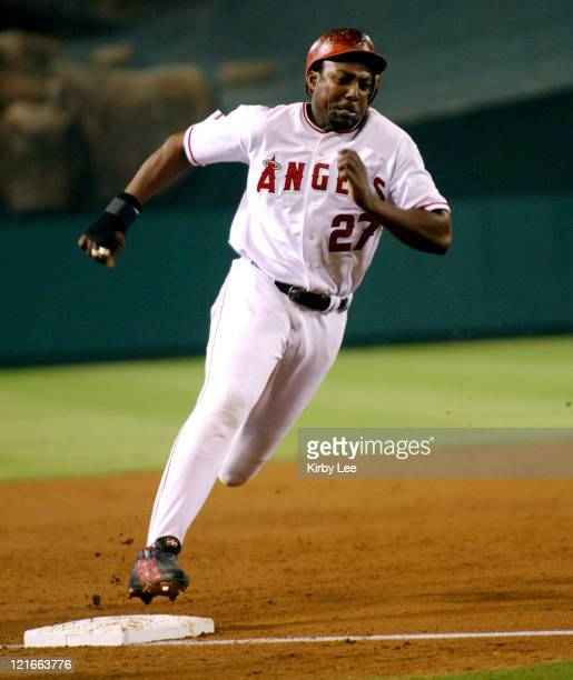 Vladimir Guerrero of the Los Angeles Angels of Anaheim rounds third base to score in the third inning of 74 victory over the Texas Rangers at Angel...