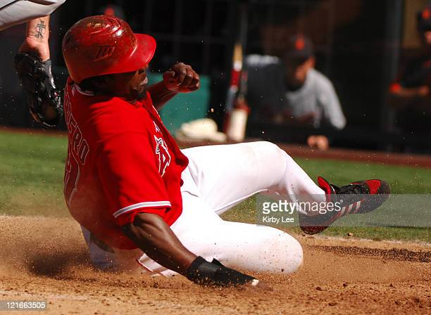 Vladimir Guerrero of the Los Angeles Angels of Anaheim slides safely into home plate on a wild pitch in the ninth inning of 98 victory over the...