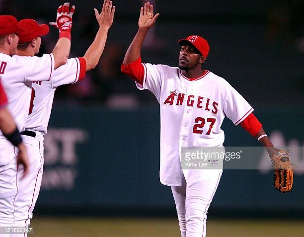 Vladimir Guerrero of the Los Angeles Angels of Anaheim who was 2 for 4 with four RBI's including a tworun firstinning home run exhanges high fives...