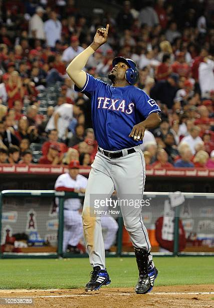 Vladimir Guerrero of the Texas Rangers celebrates his two run homerun over the Los Angeles Angels to trail 65 during the seventh inning at Angel...