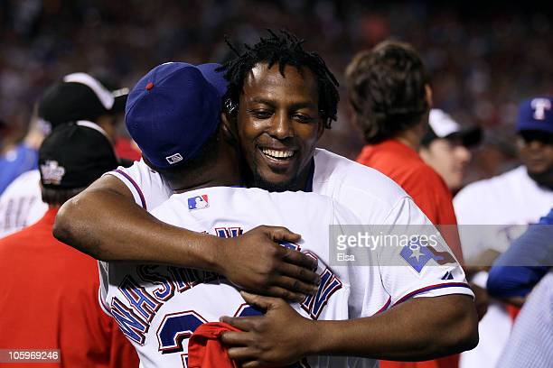 Vladimir Guerrero of the Texas Rangers celebrates with Manager Ron Washington after the Rangers won 6-1 against the New York Yankees in Game Six of...