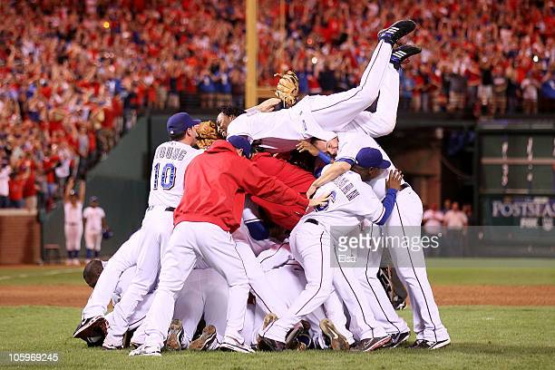Vladimir Guerrero of the Texas Rangers dives on the pile as he celebrates with his teammates after the Rangers won 6-1 against the New York Yankees...