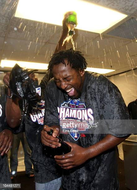 Vladimir Guerrero of the Texas Rangers is covered in champagne after they beat the Oakland Athletics to clinch the American League West Title at the...