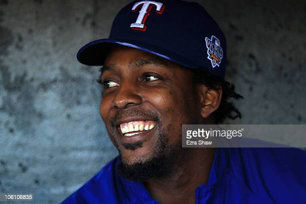 Vladimir Guerrero of the Texas Rangers smiles while sittting in the dugout during a workout session at ATT Park on October 26 2010 in San Francisco...