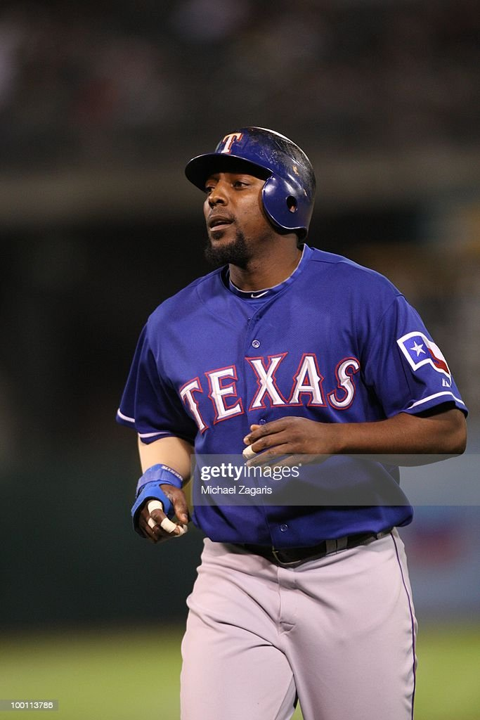 Vladimir Guerrero #27 of the Texas Rangers standing on the field during the game against the Oakland Athletics at the Oakland Coliseum on May 4, 2010 in Oakland, California. The Athletics defeated the Rangers 7-6.