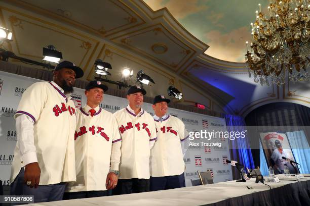 Vladimir Guerrero Trevor Hoffman Chipper Jones and Jim Thome pose for a photo following the 2018 Baseball Hall of Fame press conference announcing...