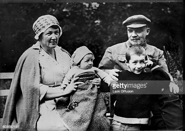 Vladimir Ilyich Ulyanov Lenin and his brother Dmitry's wife Alexandra Ulyanova with her children Olga and Victor Gorki August 1922 Photographer V...