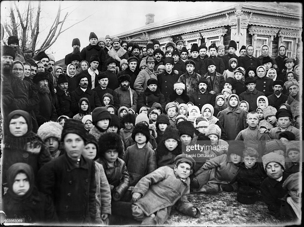 Vladimir Ilyich Ulyanov Lenin and his wife Nadezhda Krupskaya (in the middle) with residents of the village Kashino during the opening ceremony of the powerplant in Kashino, Soviet Union, on 14th November 1920. Photographer: F. Feofanov.