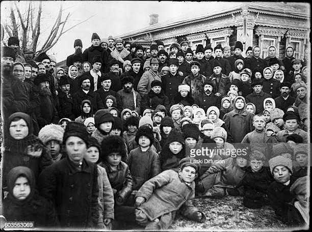 Vladimir Ilyich Ulyanov Lenin and his wife Nadezhda Krupskaya with residents of the village Kashino during the opening ceremony of the powerplant in...