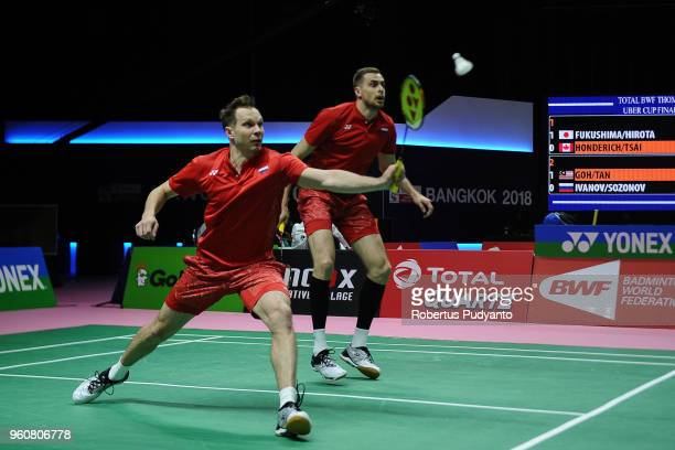 Vladimir Ivanov and Ivan Sozonov of Russia compete against Goh V Shem and Tan Wee Kiong of Malaysia during Preliminary Round on day two of the BWF...