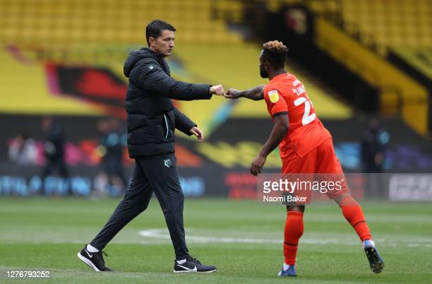 Vladimir Ivic Head Coach of Watford shakes hands with Kazenga LuaLua of Luton Town following during the Sky Bet Championship match between Watford...