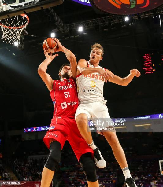 Vladimir Ivlev of Russia in action against Boban Marjanovic of Serbia during the FIBA Eurobasket 2017 semi final basketball match between Russia and...