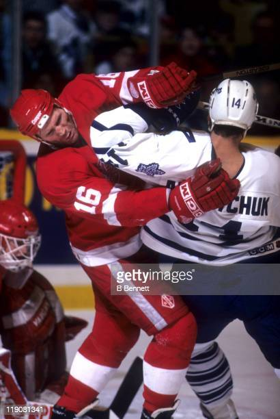 Vladimir Konstantinov of the Detroit Red Wings checks Dave Andreychuk of the Toronto Maple Leafs in front of the net during their game circa 1995 at...