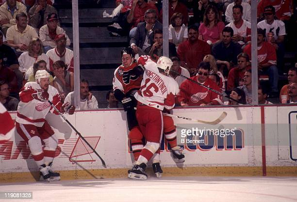 Vladimir Konstantinov of the Detroit Red Wings checks Rod Brind'Amour of the Philadelphia Flyers into the boards during Game 3 of the 1997 Stanley...