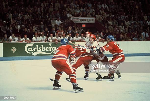 Vladimir Kovin of the Soviet Union skates against Oldrich Machac Miroslav Dvorak and Milan Novy of team Czechoslovakia during a Canada Cup game on...