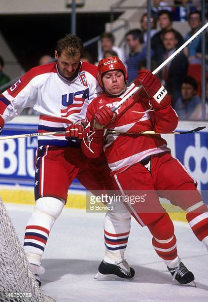 Vladimir Krutov of the Soviet Union is hooked by Rod Langway of the United States on September 4 1987 at the Hartford Civic Center in Hartford...
