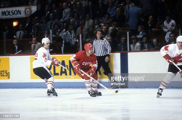 Vladimir Krutov of the Soviet Union skates on the ice while being defended by Mike Bossy of Canada during the 1984 Canada Cup on September 13 1984 at...