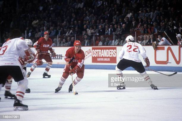 Vladimir Krutov of the Soviet Union skates with the puck while being defended by Mike Bossy of Canada during the 1984 Canada Cup on September 13 1984...
