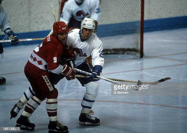 Vladimir Krutov of the USSR is checked by Dave Pichette of the Quebec Nordiques during the 198283 Super Series on December 30 1982 at the Quebec...