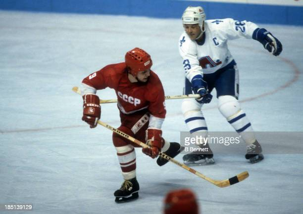 Vladimir Krutov of the USSR passes the puck as Andre Dupont of the Quebec Nordiques follows behind during the 198283 Super Series on December 30 1982...