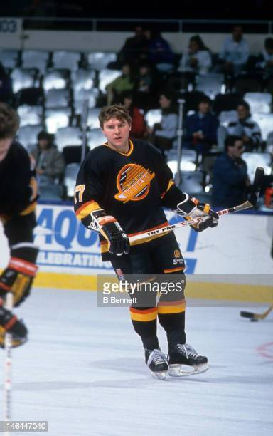 Vladimir Krutov of the Vancouver Canucks warmsup before an NHL game against the New York Islander circa 1990 at the Nassau Coliseum in Uniondale New...