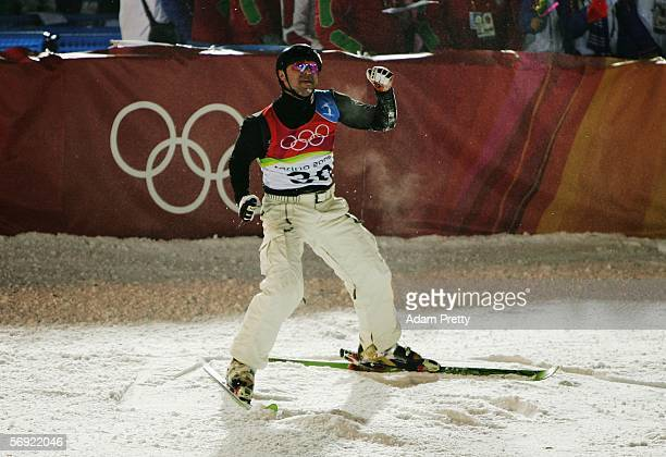Vladimir Lebedev of Russia celebrates after his final jump to winning the bronze medal in Mens Freestyle Skiing Aerials Final on Day 13 of the 2006...