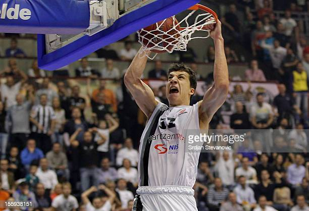 Vladimir Lucic of BC Partizan slam dunks during the 2012-2013 Turkish Airlines Euroleague Regular Season Game Day 5 Group D game between Partizan...