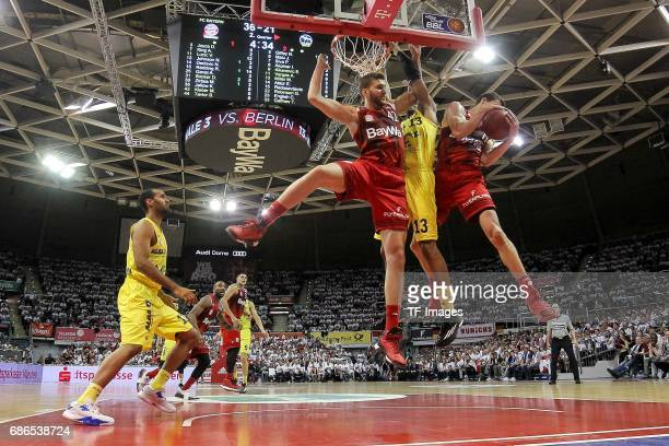 Vladimir Lucic of Munich Maximilian Kleber of Munich und Malcolm Miller of Berlin battle for the ball during the easyCredit BBL Basketball Bundesliga...
