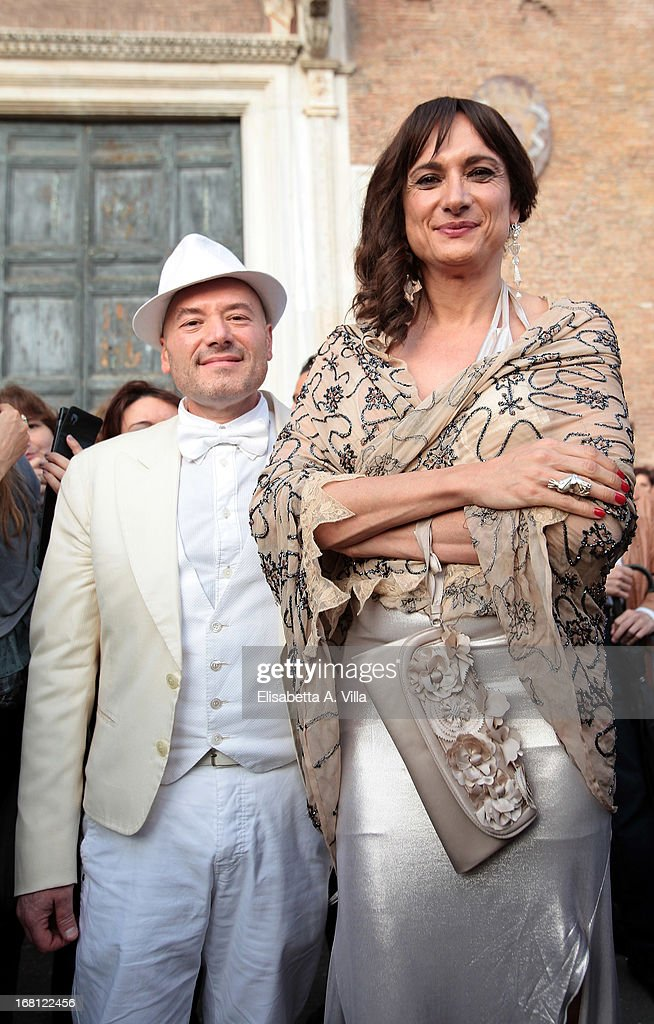 Vladimir Luxuria (R) and Francesco Caruso Litrico (R) attend the Valeria Marini and Giovanni Cottone wedding at Ara Coeli on May 5, 2013 in Rome, Italy.