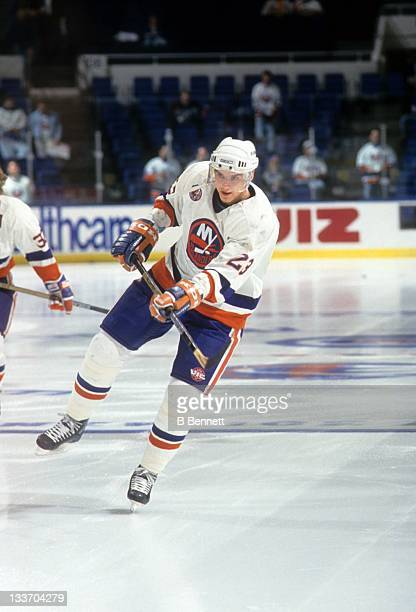 Vladimir Malakhov of the New York Islanders skates on the ice during warmups before an NHL game in April 1993 at the Nassau Coliseum in Uniondale New...