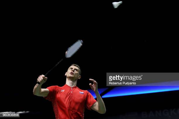 Vladimir Malkov of Russia competes against Lee Chong Wei of Malaysia during Preliminary Round on day two of the BWF Thomas Uber Cup at Impact Arena...