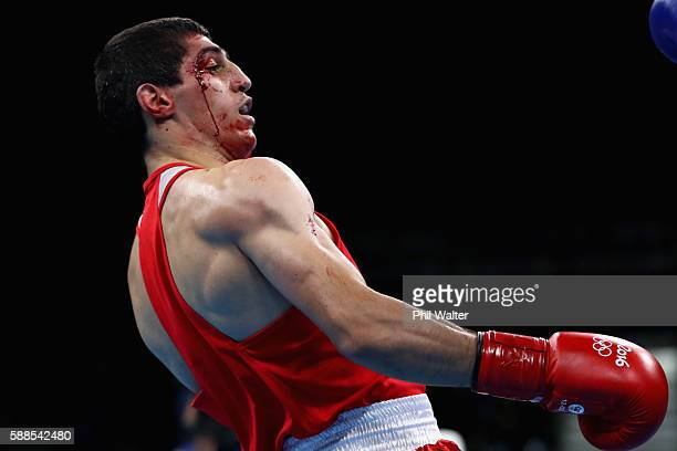 Vladimir Margaryan of Armenia suffers a cut in his fight against Roniel Iglesais of Cuba in their Mens Welterweight bout on Day 6 of the 2016 Rio...
