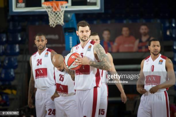 Vladimir Micov #5 of AX Armani Exchange Olimpia Milan Amath MÕBaye #24 Jordan Theodore #25 Kaleb Tarczewski #15 and Mantas Kalnietis #9 in action...
