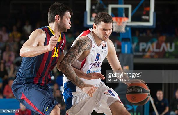 Vladimir Micov #5 of CSKA Moscow competes with Kostas Papanikolau #16 of FC Barcelona during the 20132014 Turkish Airlines Euroleague Regular Season...