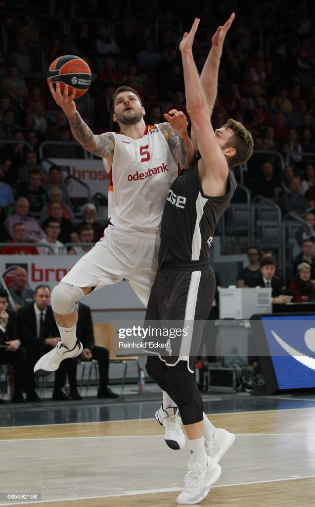 Vladimir Micov, #5 of Galatasaray Odeabank Istanbul competes with Nicolo Melli, #4 of Brose Bamberg in action during the 2016/2017 Turkish Airlines EuroLeague Regular Season Round 30 game between Brose Bamberg v Galatasaray Odeabank Istanbul at Brose Arena on April 6, 2017 in Bamberg, Germany.