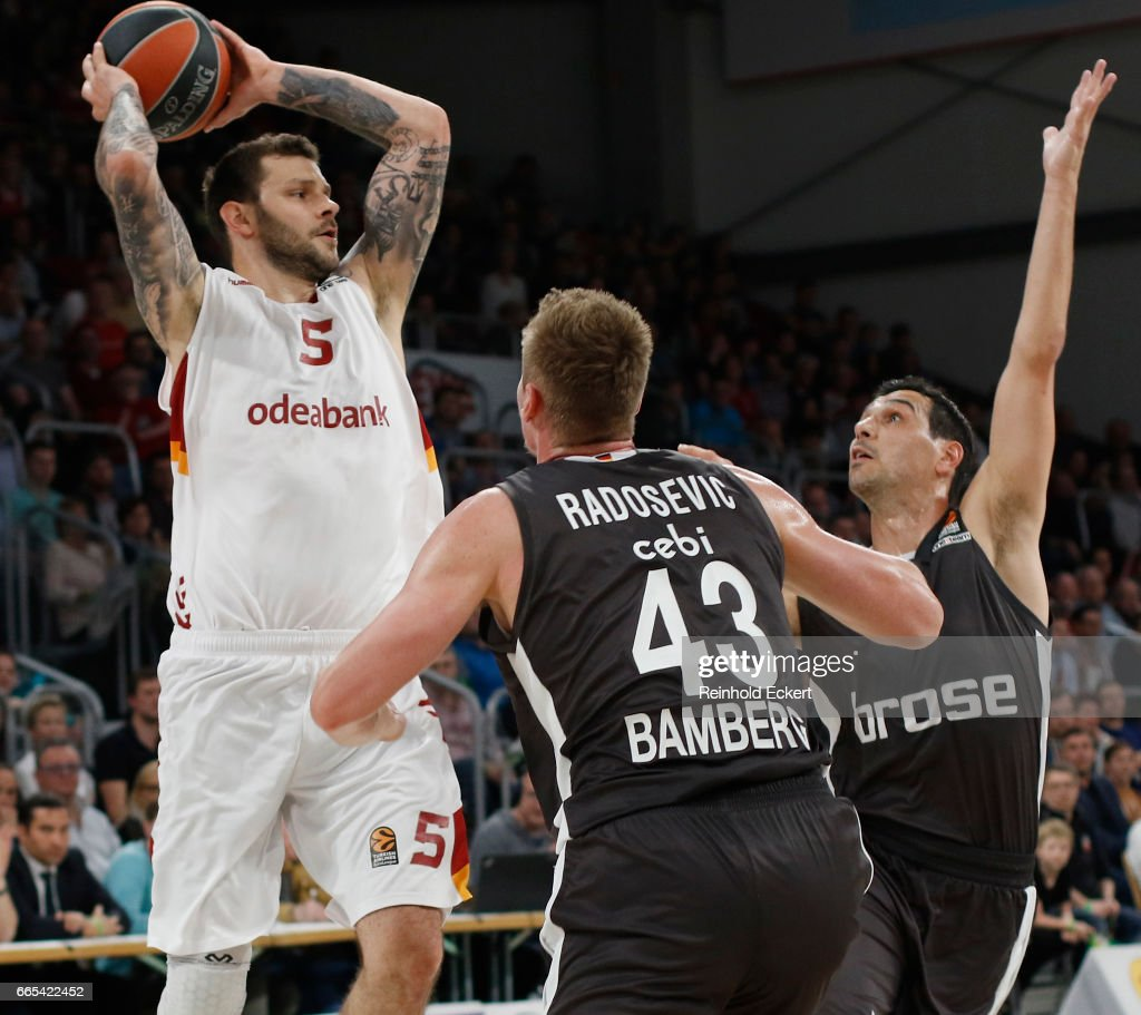 Vladimir Micov, #5 of Galatasaray Odeabank Istanbul competes with Nikos Zisis, #6 of Brose Bamberg in action during the 2016/2017 Turkish Airlines EuroLeague Regular Season Round 30 game between Brose Bamberg v Galatasaray Odeabank Istanbul at Brose Arena on April 6, 2017 in Bamberg, Germany.