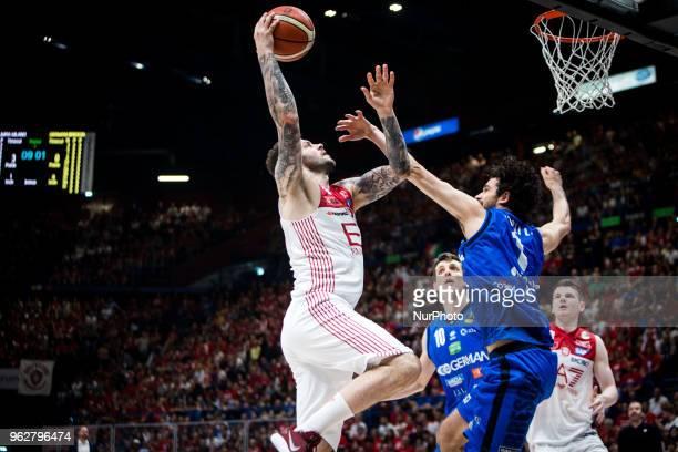 Vladimir Micov drives to the basket during a basketball game of Poste Mobile Playoff Lega Basket A between EA7 Emporio Armani Milano vs Germani...